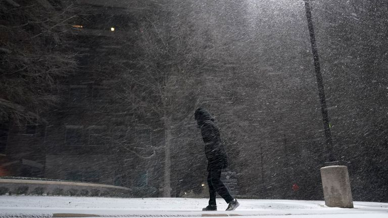 person walking in snowstorm