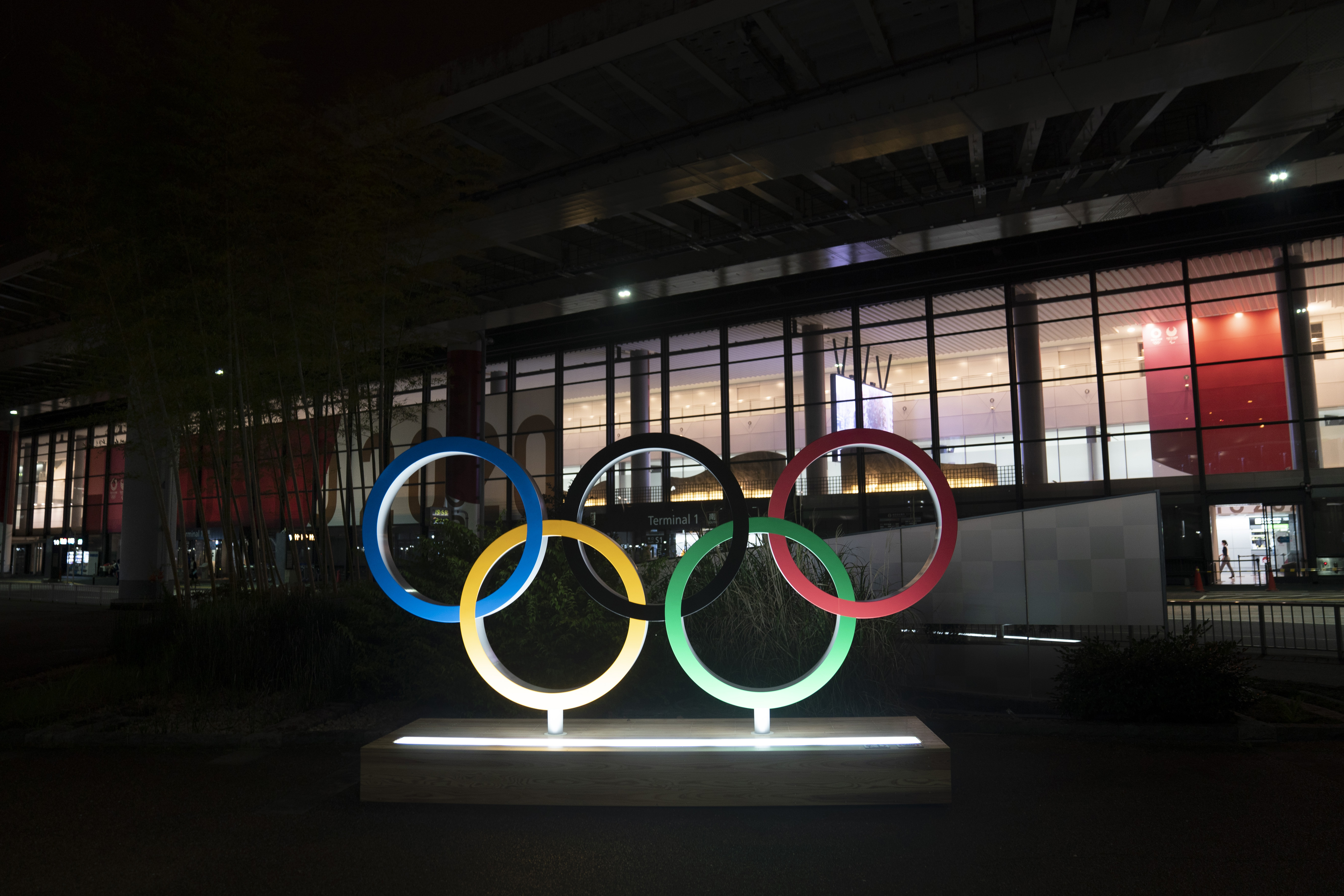 FILE - In this Saturday, July 10, 2021, file photo, the Olympic rings are illuminated outside the Narita International Airport prior to the 2020 Summe