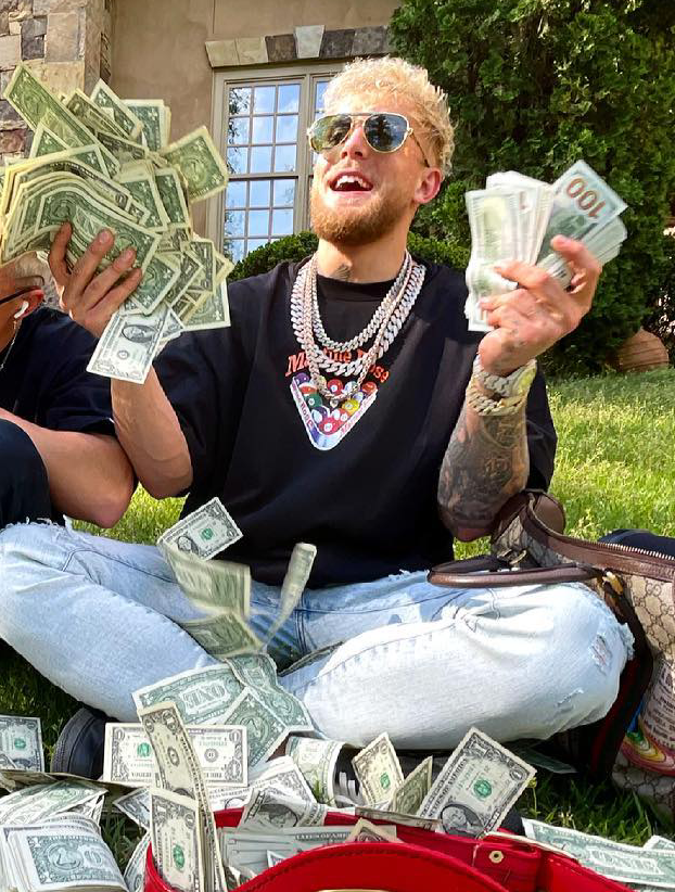 Paul-with-money-in-yard.0.png