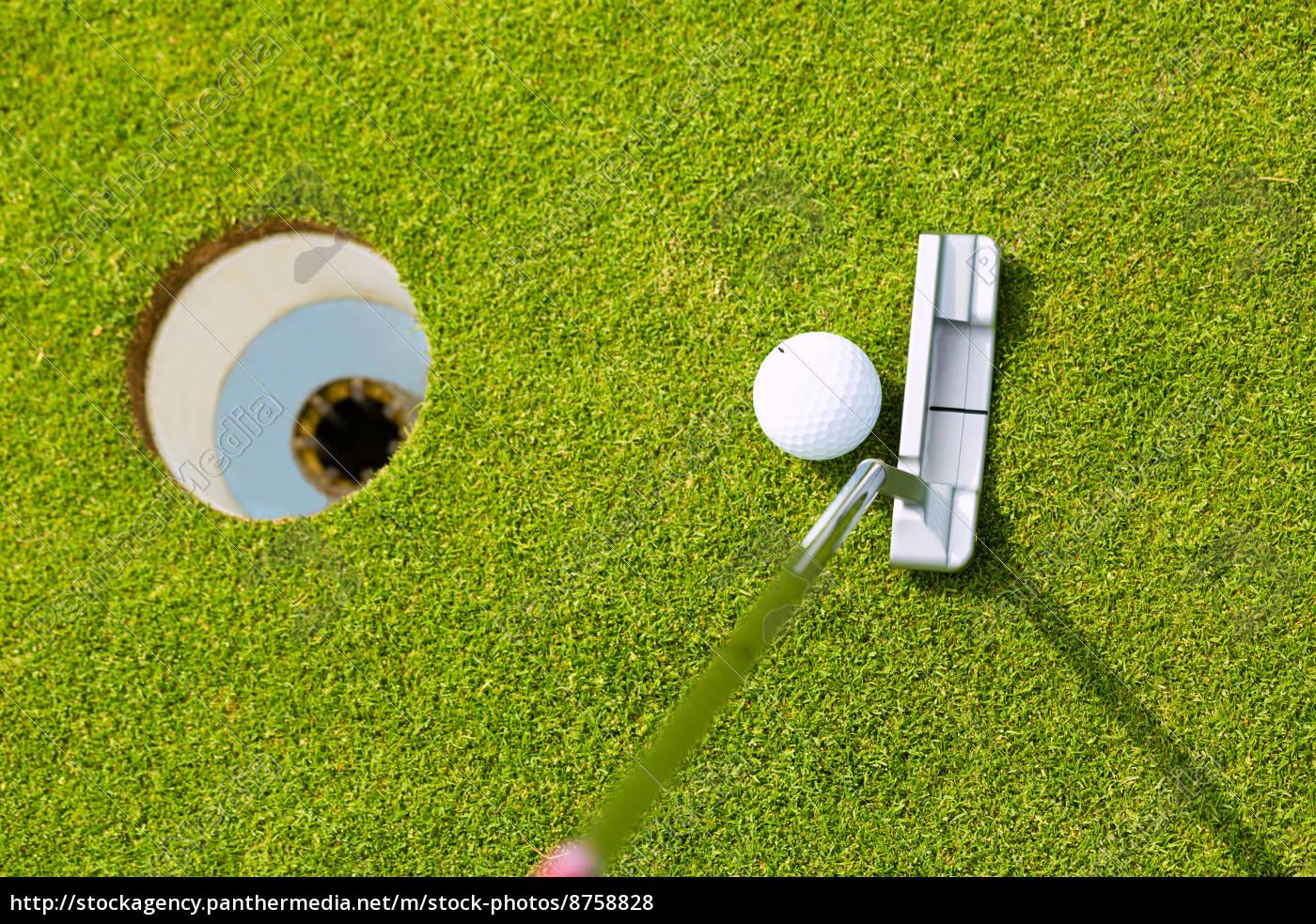 _golfers-playing-golf-at-putting_08758828_high.0.jpg