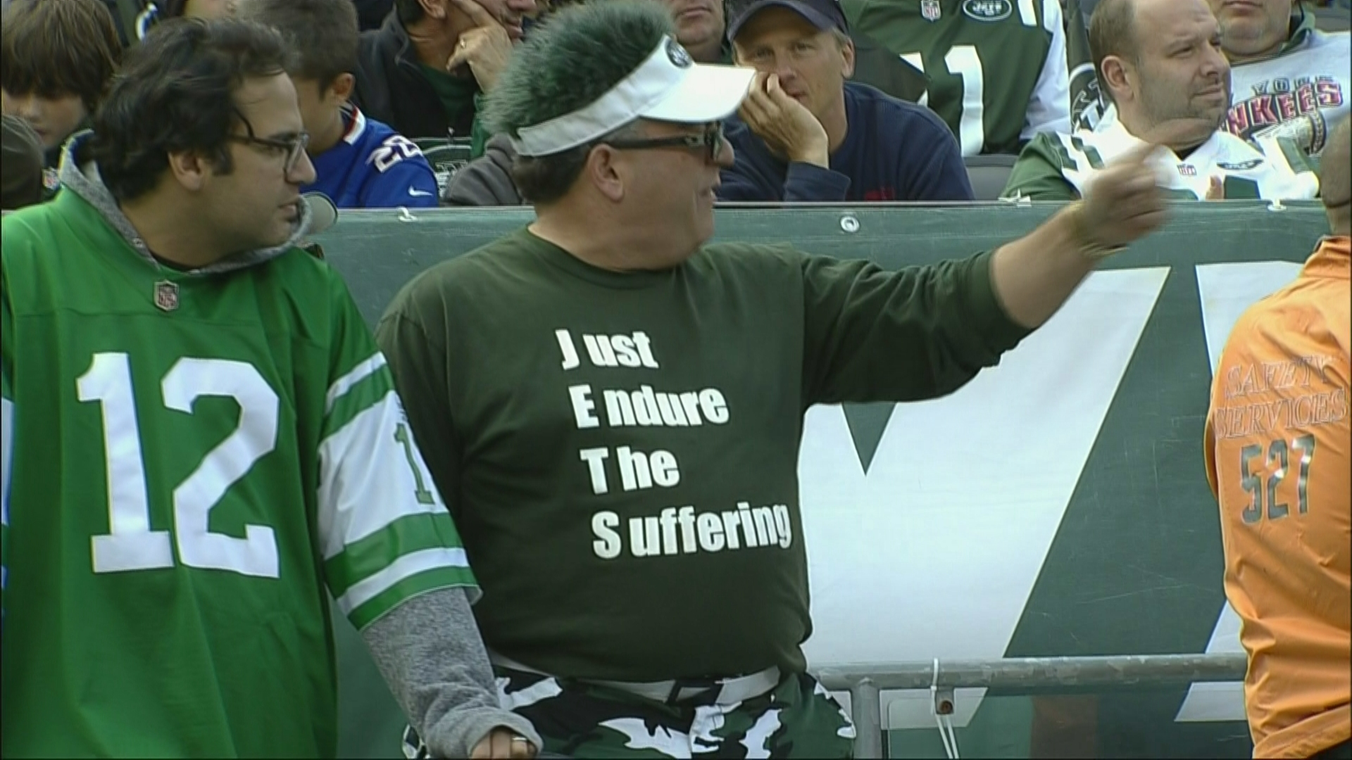 Jets fan's shirt reveals what 'J-E-T-S' stands for