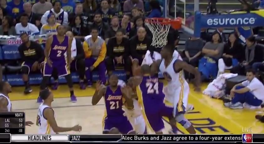 Kobe Bryant somehow gets the roll on this and-1 circus shot