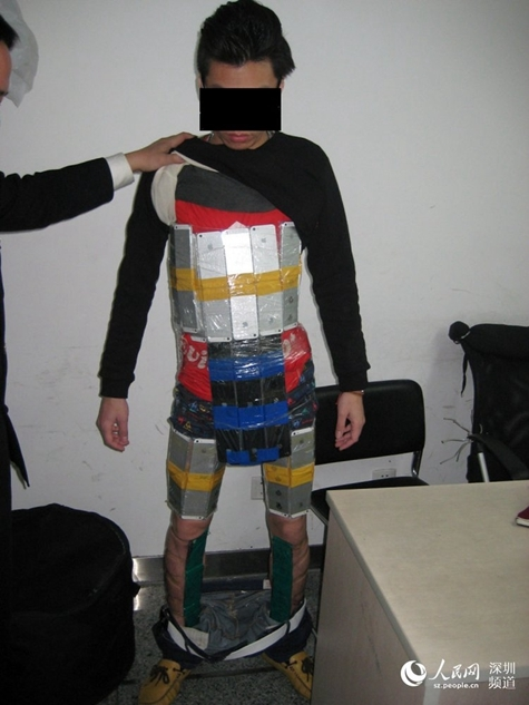 This is how you smuggle 94 iPhones over the Chinese border ...