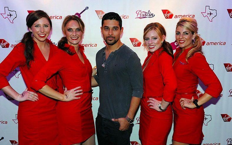 f247f95baba562 Wilmer Valderrama and the Virgin America flight attendants in their Banana  Republic-made uniforms