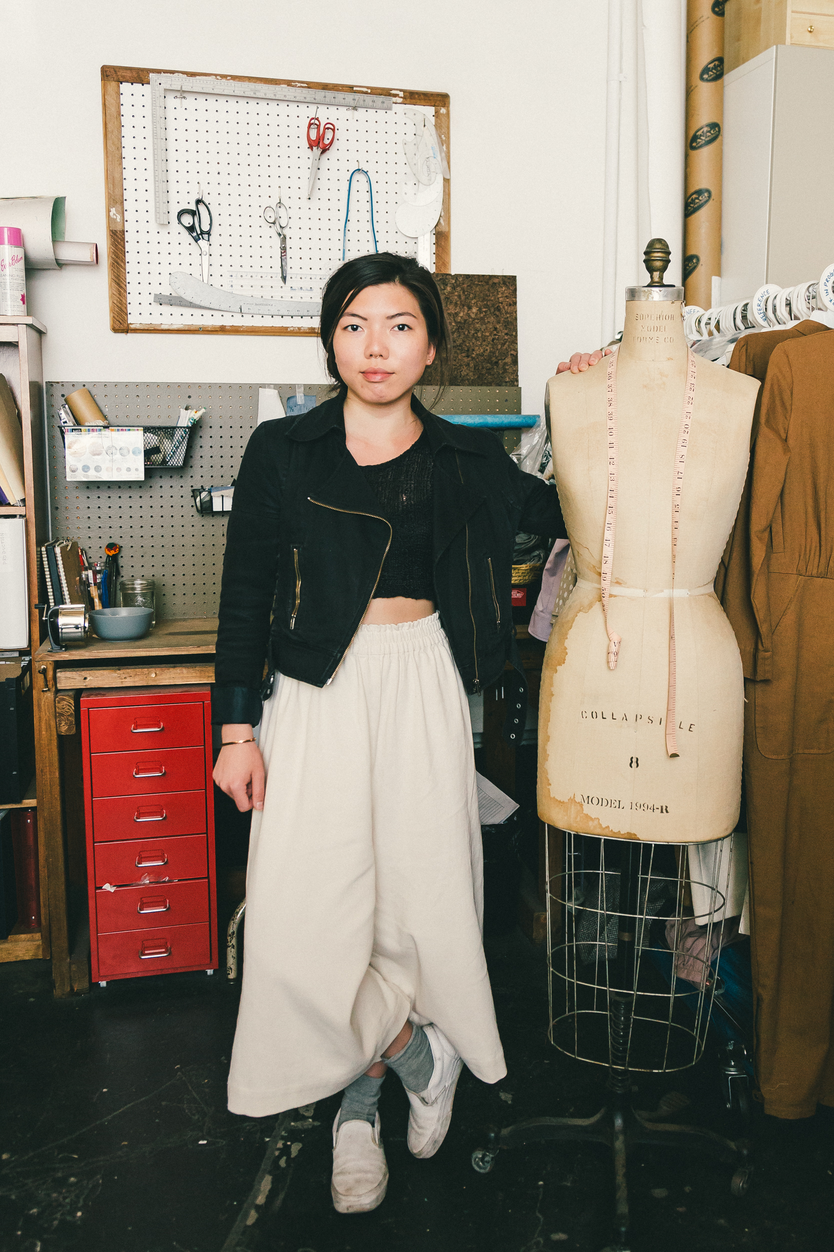 alexis lam apparel production manager wears a twist tango jacket a vintage sweater hm pants vans sneakers an acb bracelet and winden earrings - Fashion Production Manager