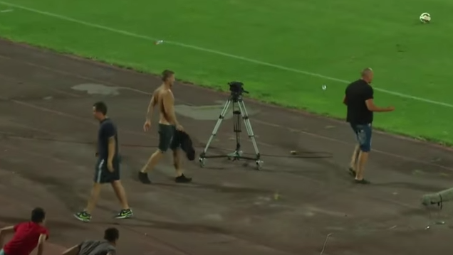 Fans chase terrified soccer players from field after bad tackle