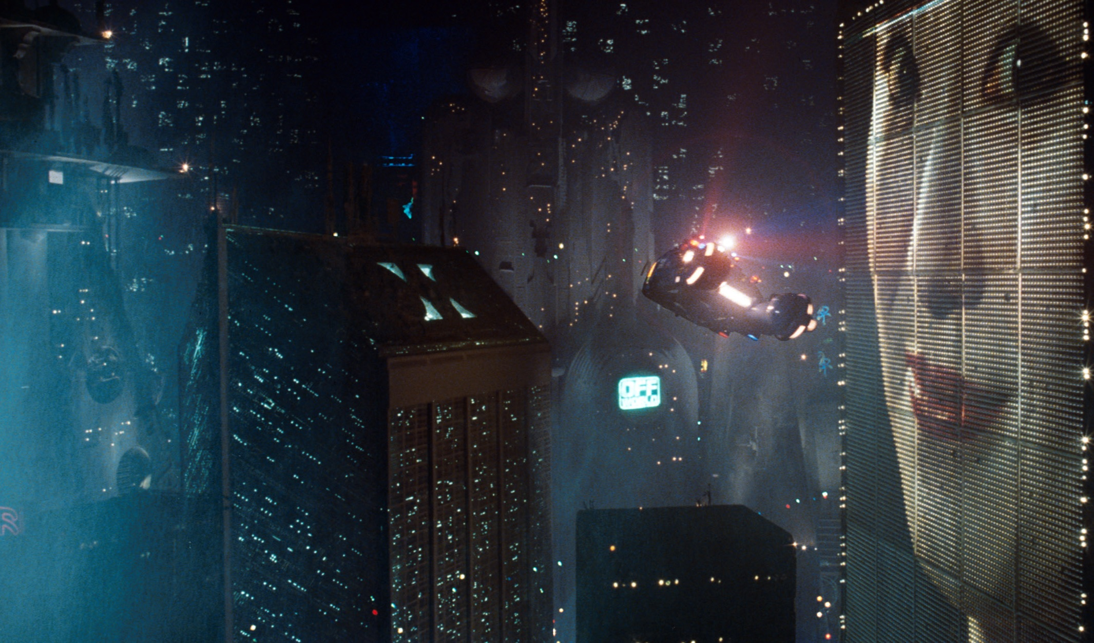 Asian woman on building-size advertisement in Blade Runner