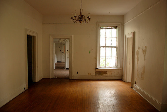 empty apartment inside. At least one of these historic buildings was empty  its front door left wide open in the morning interior walls peeling and unrestored A 24 Hour Stay on Rapidly Changing Governors Island Curbed NY