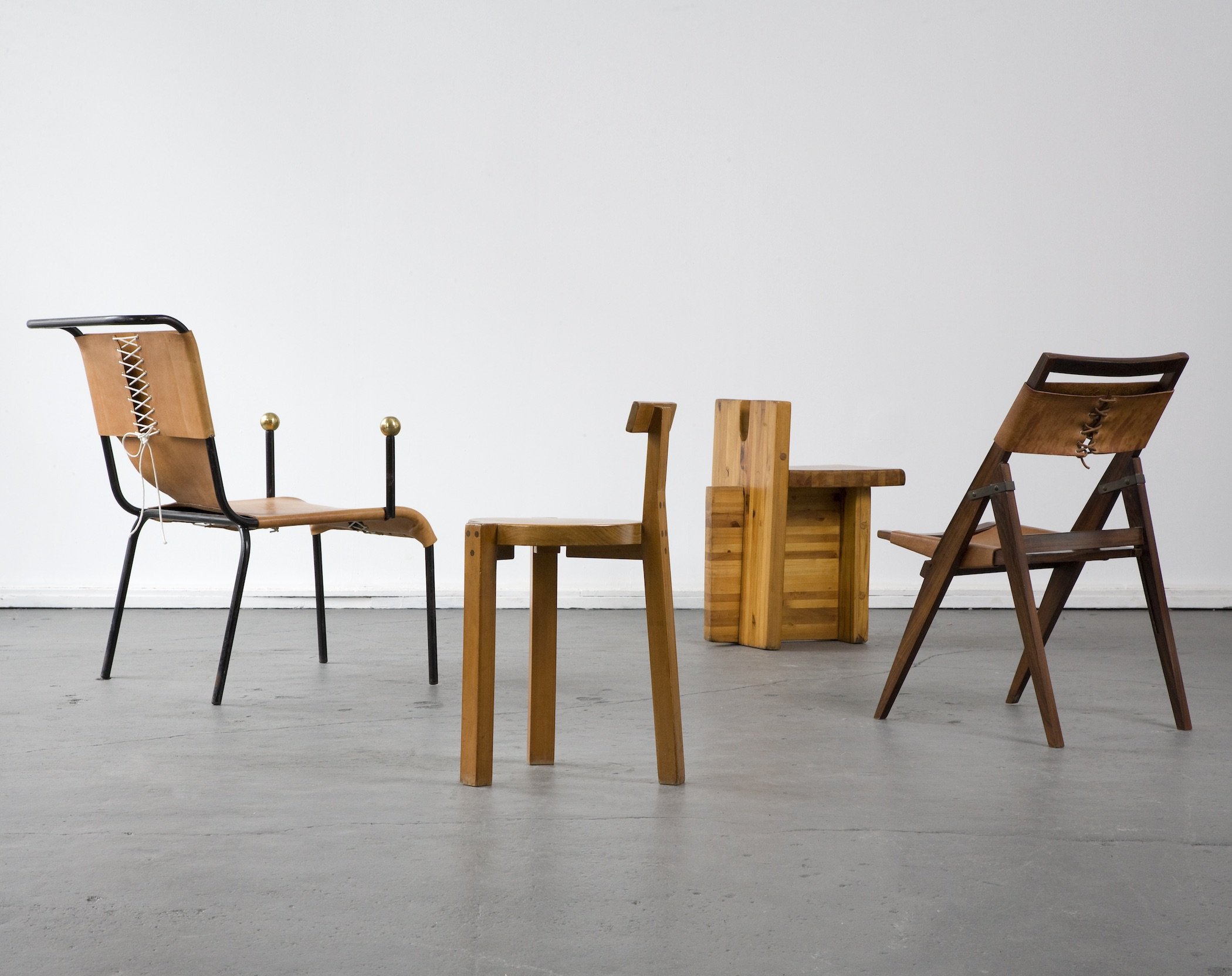 Brazilian Furniture Company. Grouping of chairs designed by Lina Bo Bardi,  Brazil between the 1950s and the 1980s