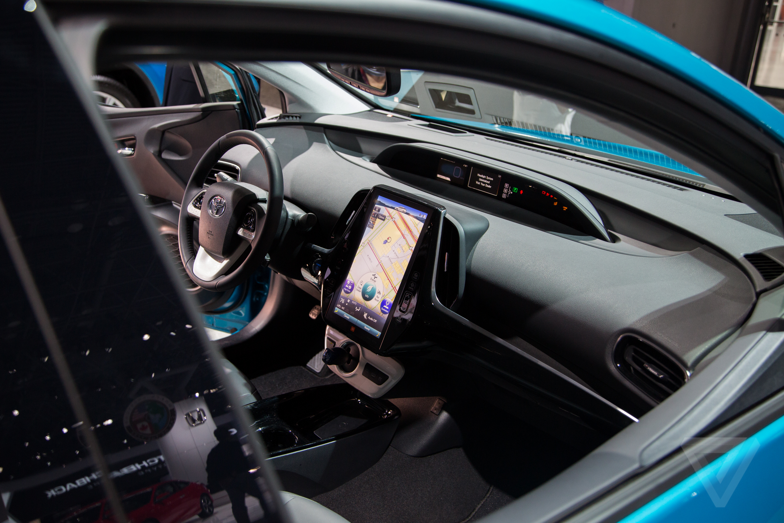 The Toyota Prius Prime's high-tech interior has a 'budget Tesla
