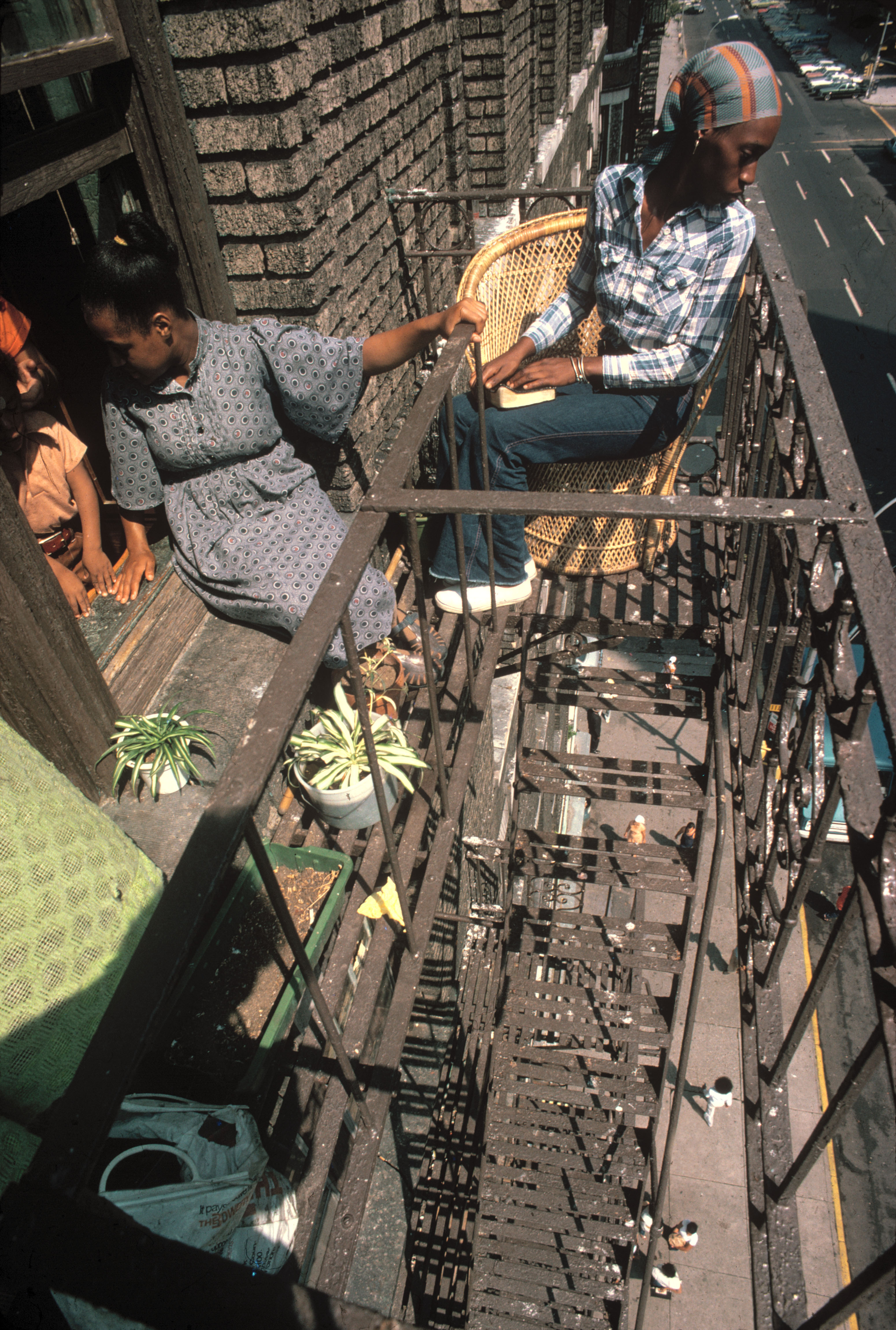Fire Escape New York City 1940s : Balcony seats to the city curbed