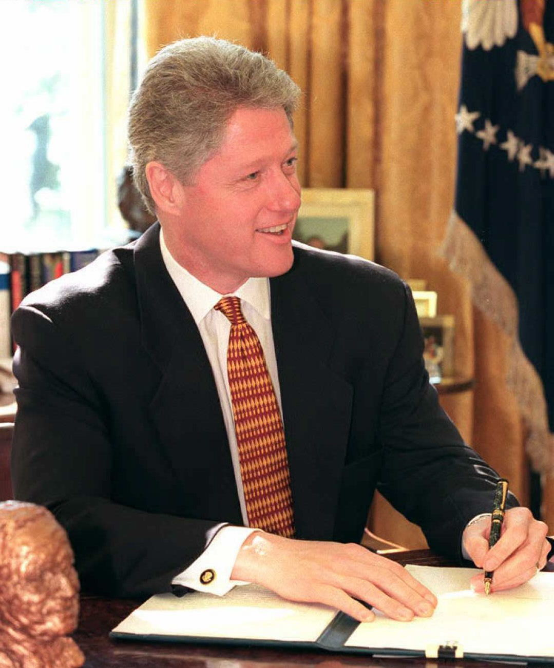 Image result for president clinton signing a congressional  resolution in 1994