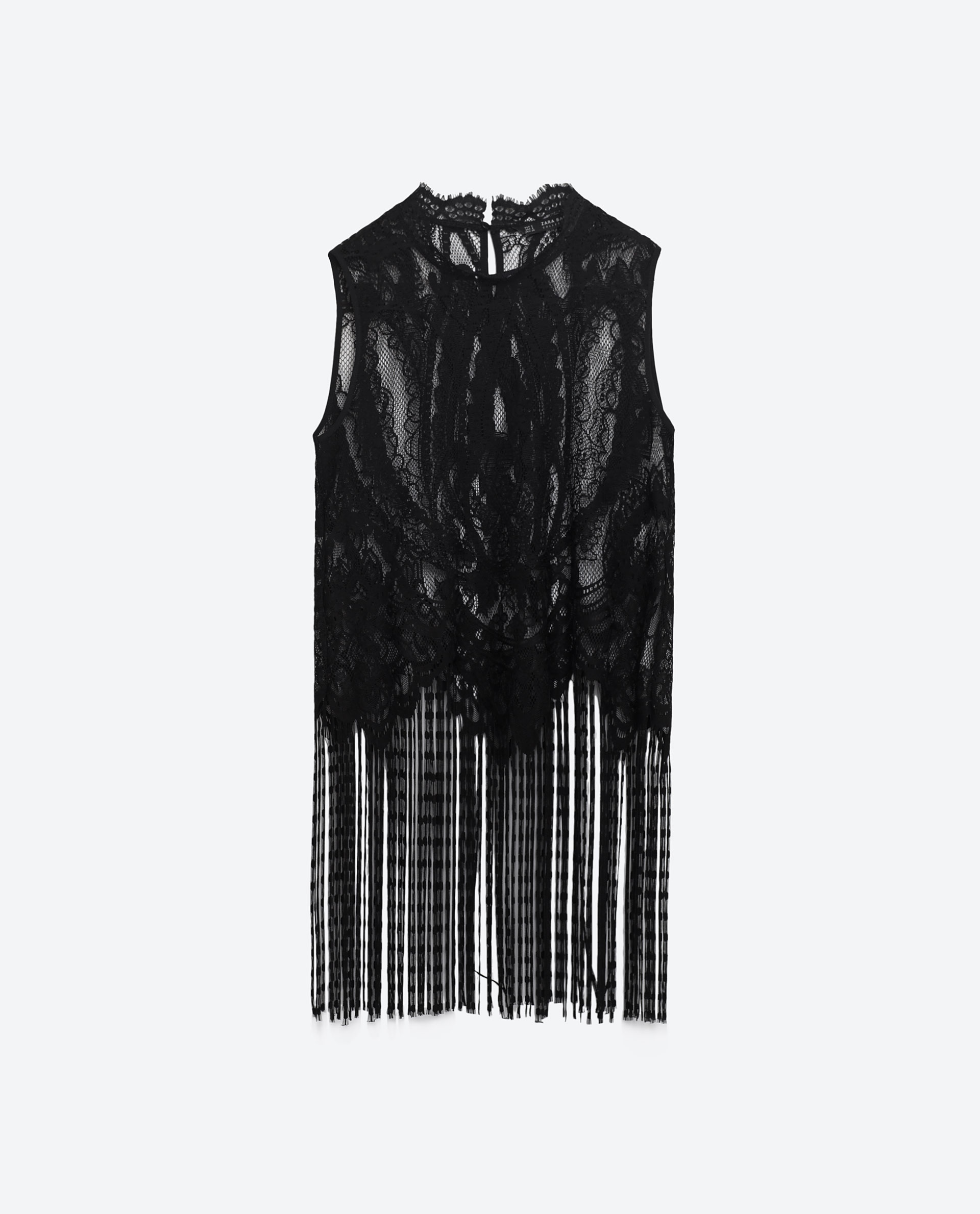 64815f1282d Counter all the intricate details of Zara s lace and fringe top with a  crisp black trouser beneath. Zara fringed blonde lace top