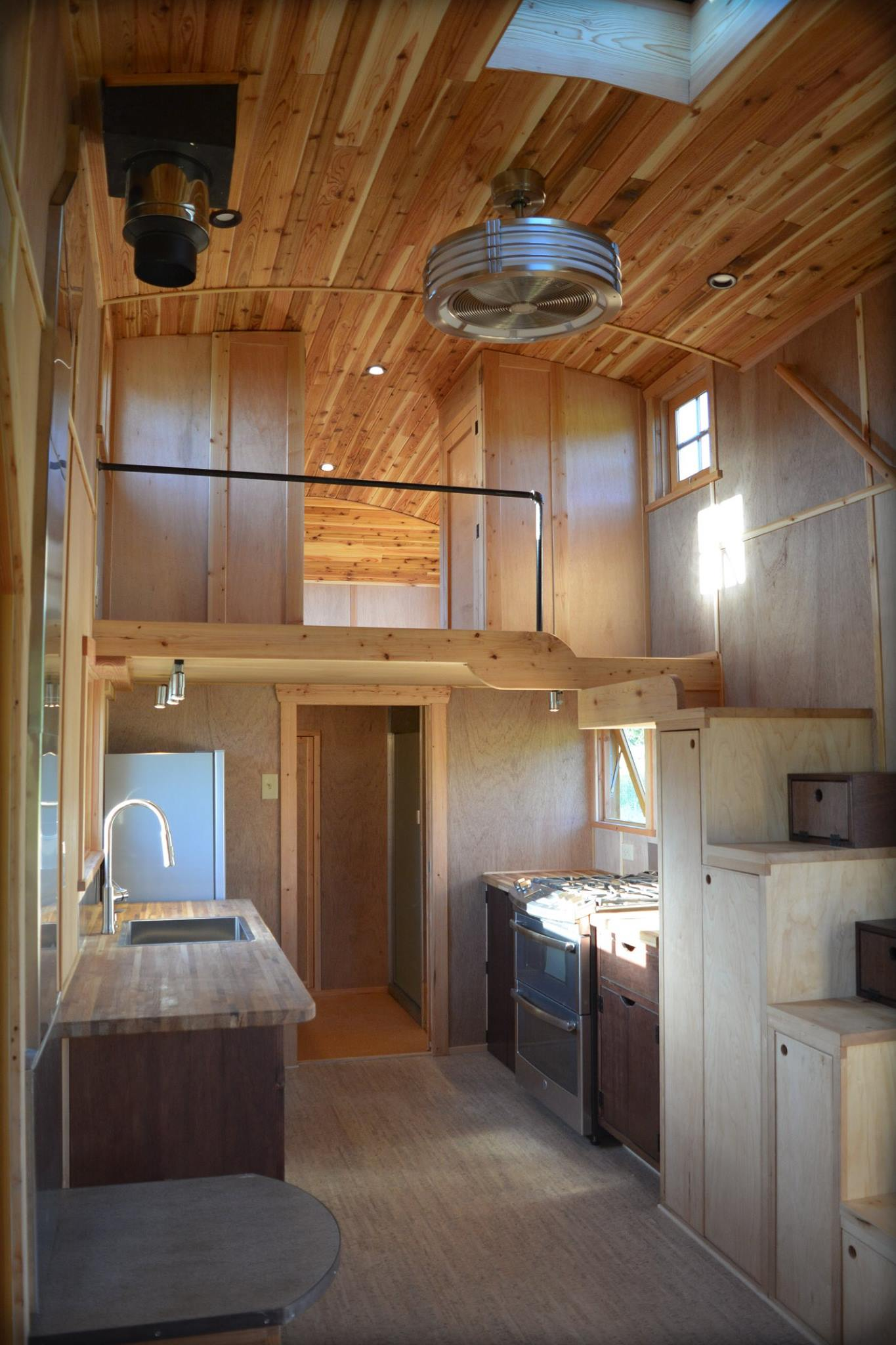 New Tiny House Lives Large With Extra-High Ceiling and Fun Curves ...