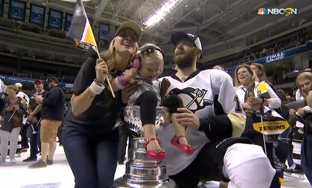 Penguins players are placing their adorable babies on top of the Stanley Cup