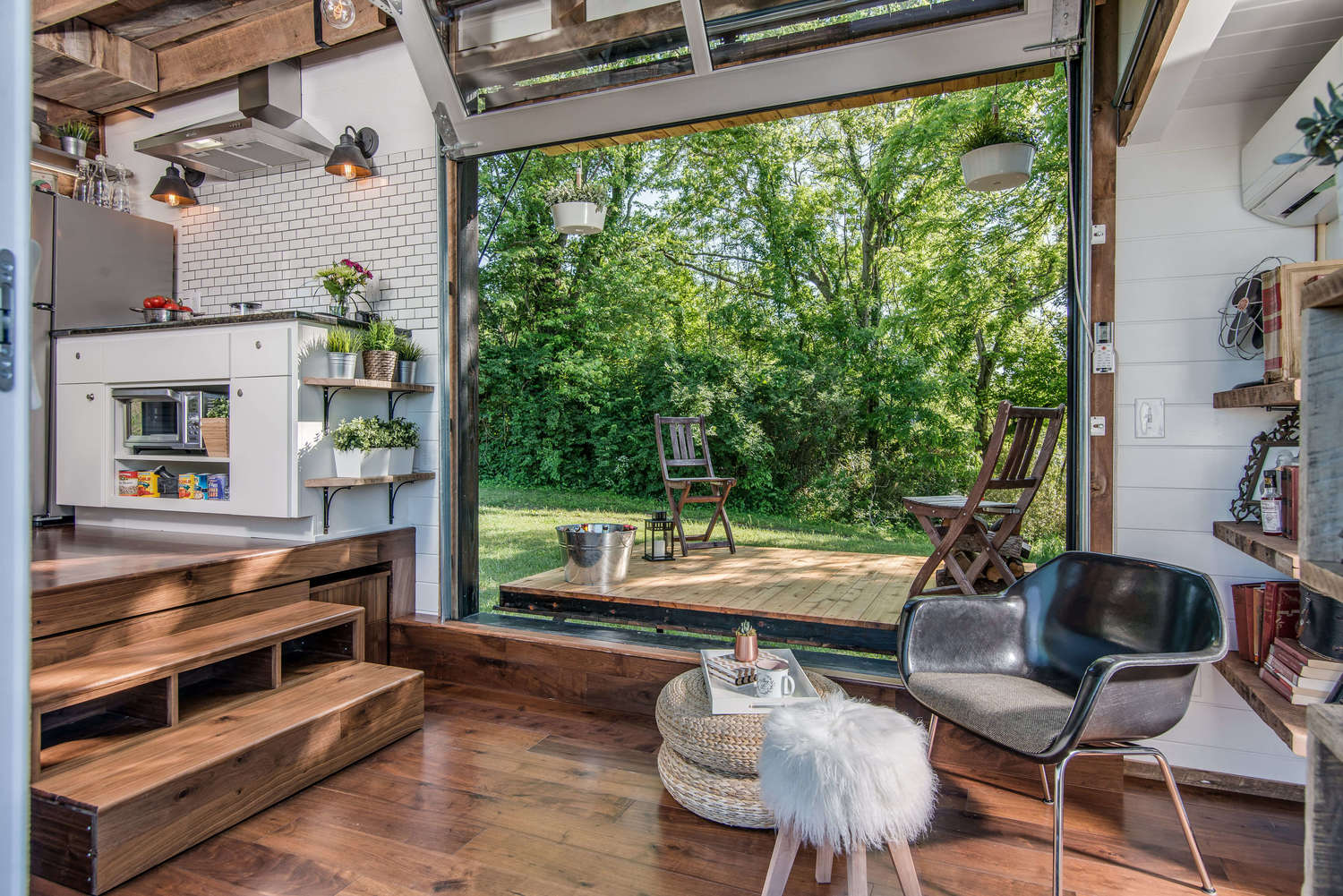 Tricked out tiny home features garage door and custom deck for Small house deck designs