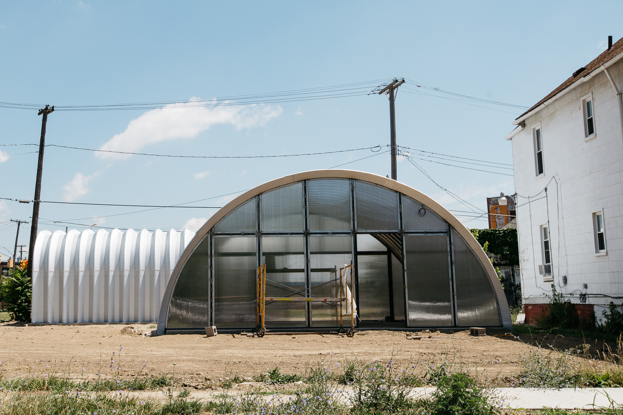 On grand river a community of quonset huts is taking for Quonset hut