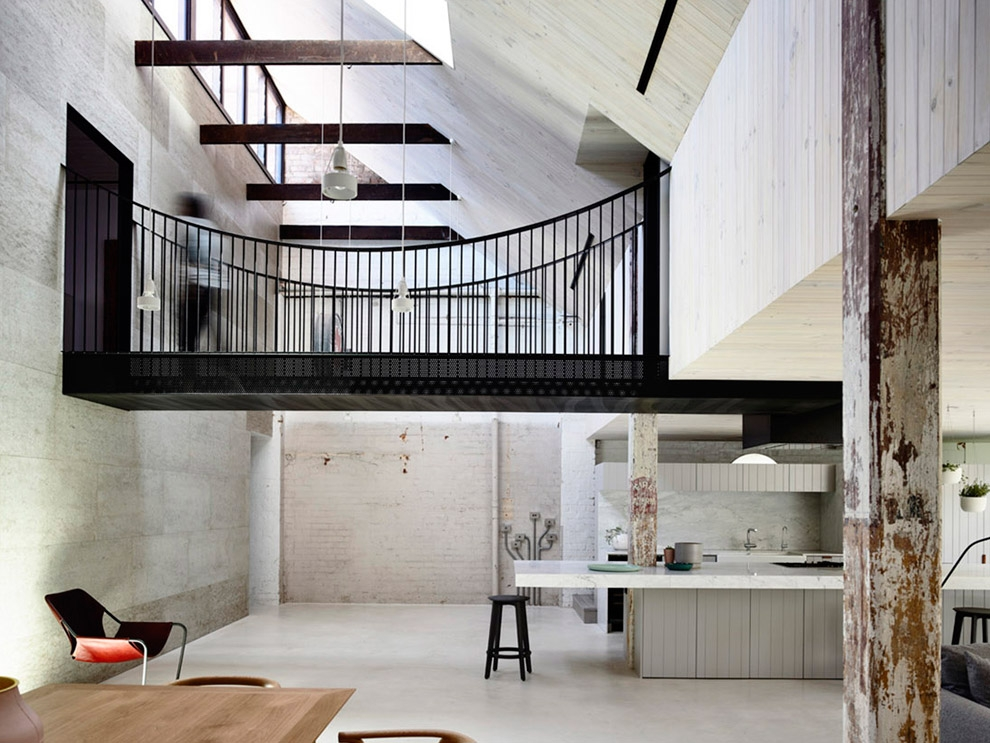 This timber-and-steel former warehouse turned light-filled loft home  features a skywalk for the upper floor bedrooms, as well as an interior  courtyard under ...