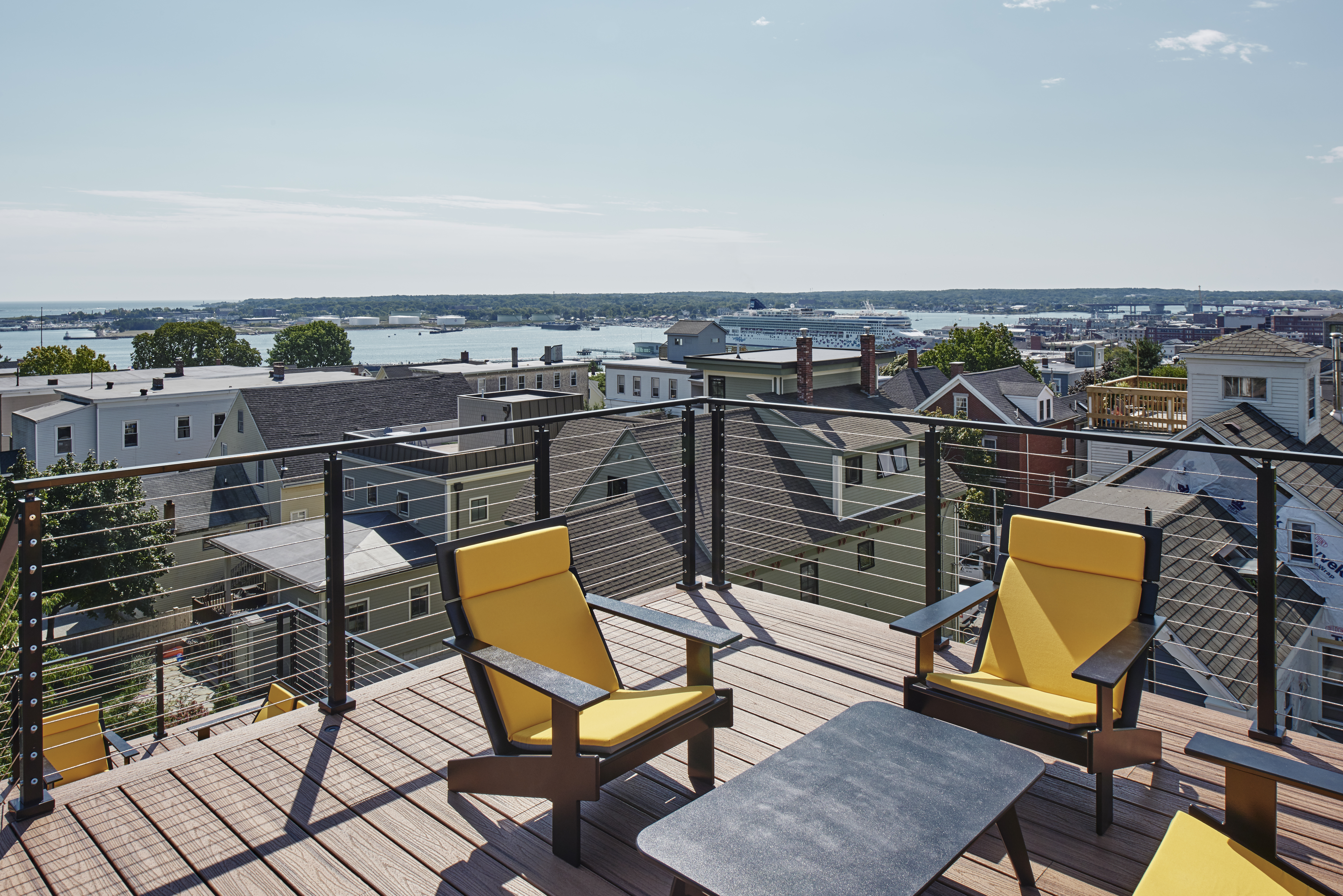 A modern house with maritime views rises on a hill in Portland, Maine