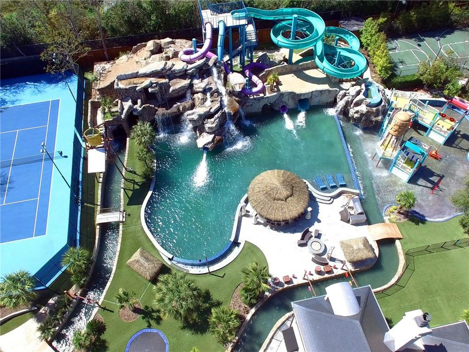 Mansions With Pools And Waterslides $32m texas mansion has waterpark, in-ground trampoline in backyard