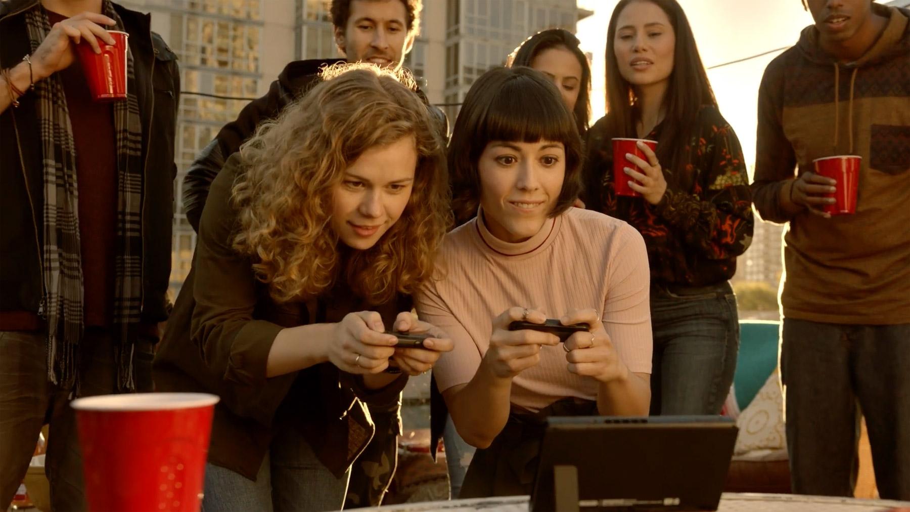 Nintendo Swap - 'Karen' playing switch on rooftop