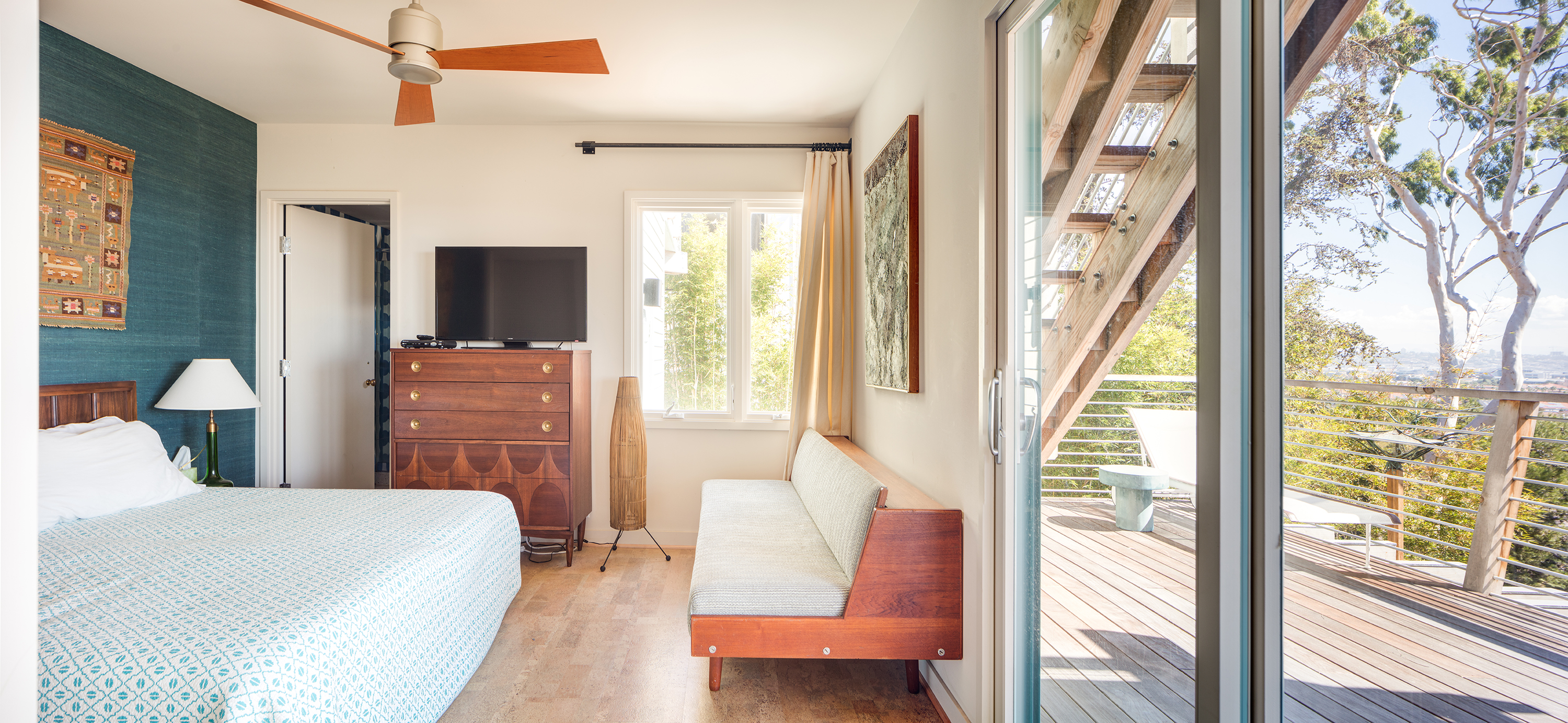 The New Deck Gives This Lower Level Bedroom A Connection To Outdoors That Makes It Feel Larger