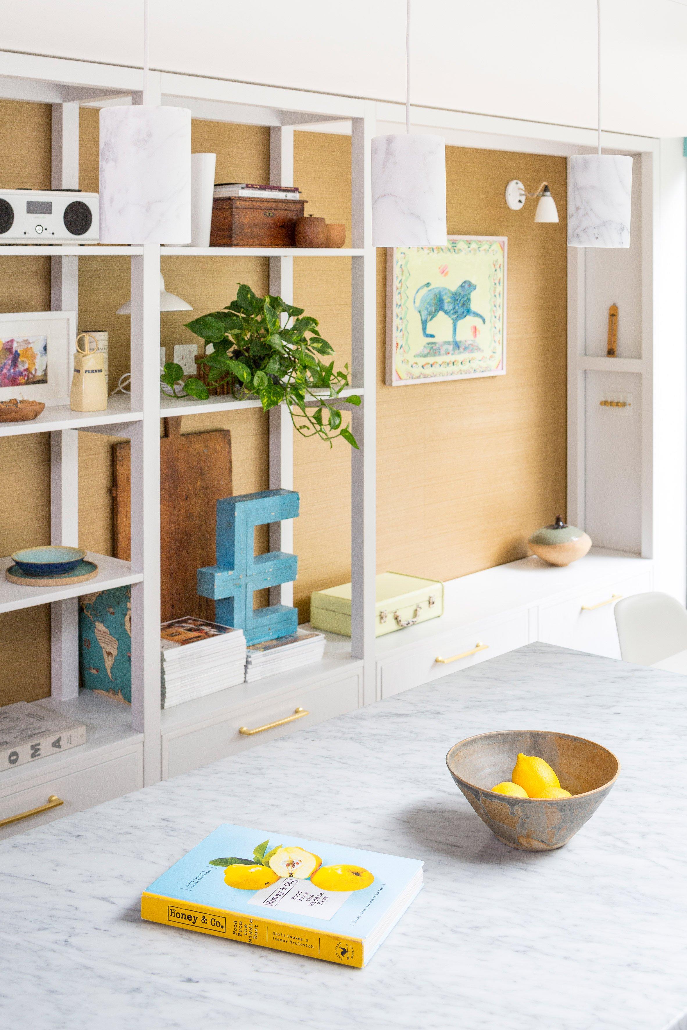 Marble, brass, and herringbone floors make this London renovation shine