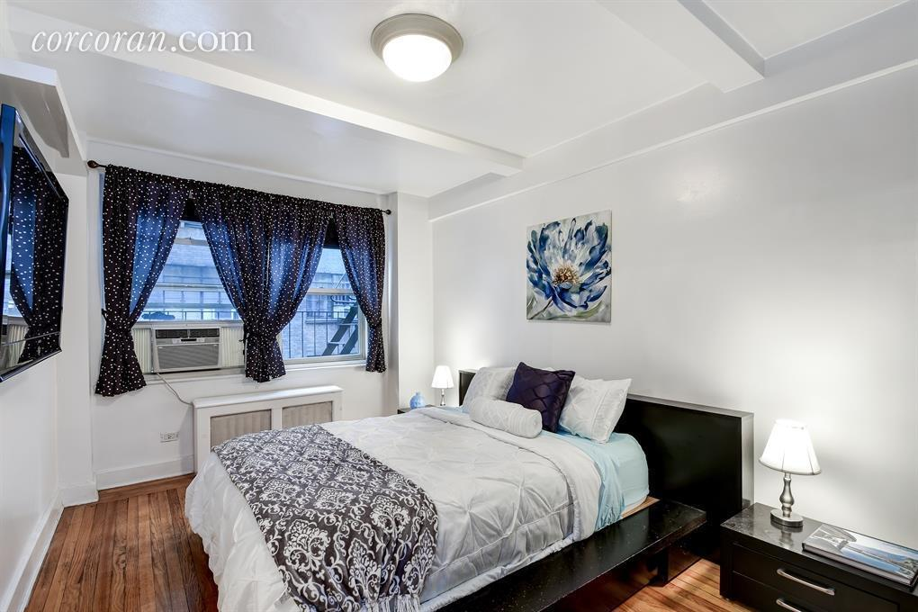 the bedroom is a bit on the small side but two huge windows invite in lots of natural light and there is one of the three large closets within