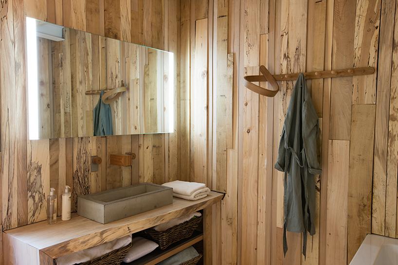 Furniture designer builds himself a curvy, wooden dream home - Curbed