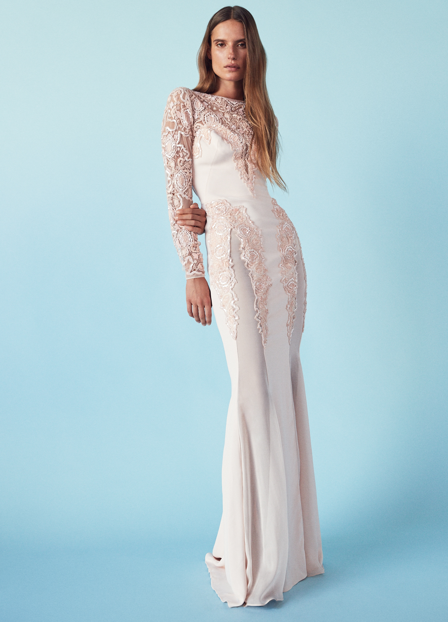 A Model Wearing An Off White Embroidered Wedding Gown By Zuhair Murad