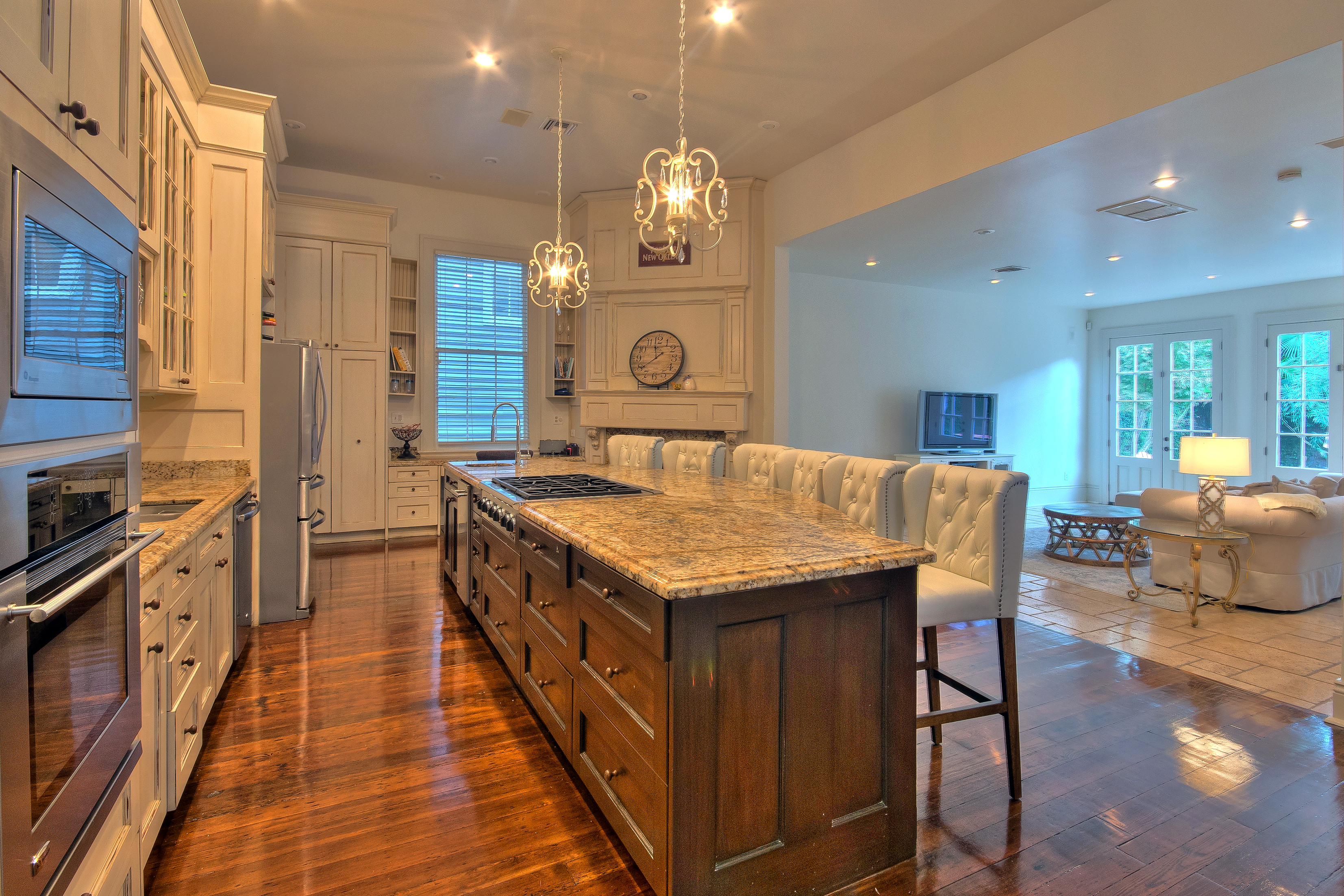 roomy elegant lower garden district greek revival hits market at the kitchen has a spacious island with a stone finish the island which can seat up to four best comfortably is equipped with a four burner stove and