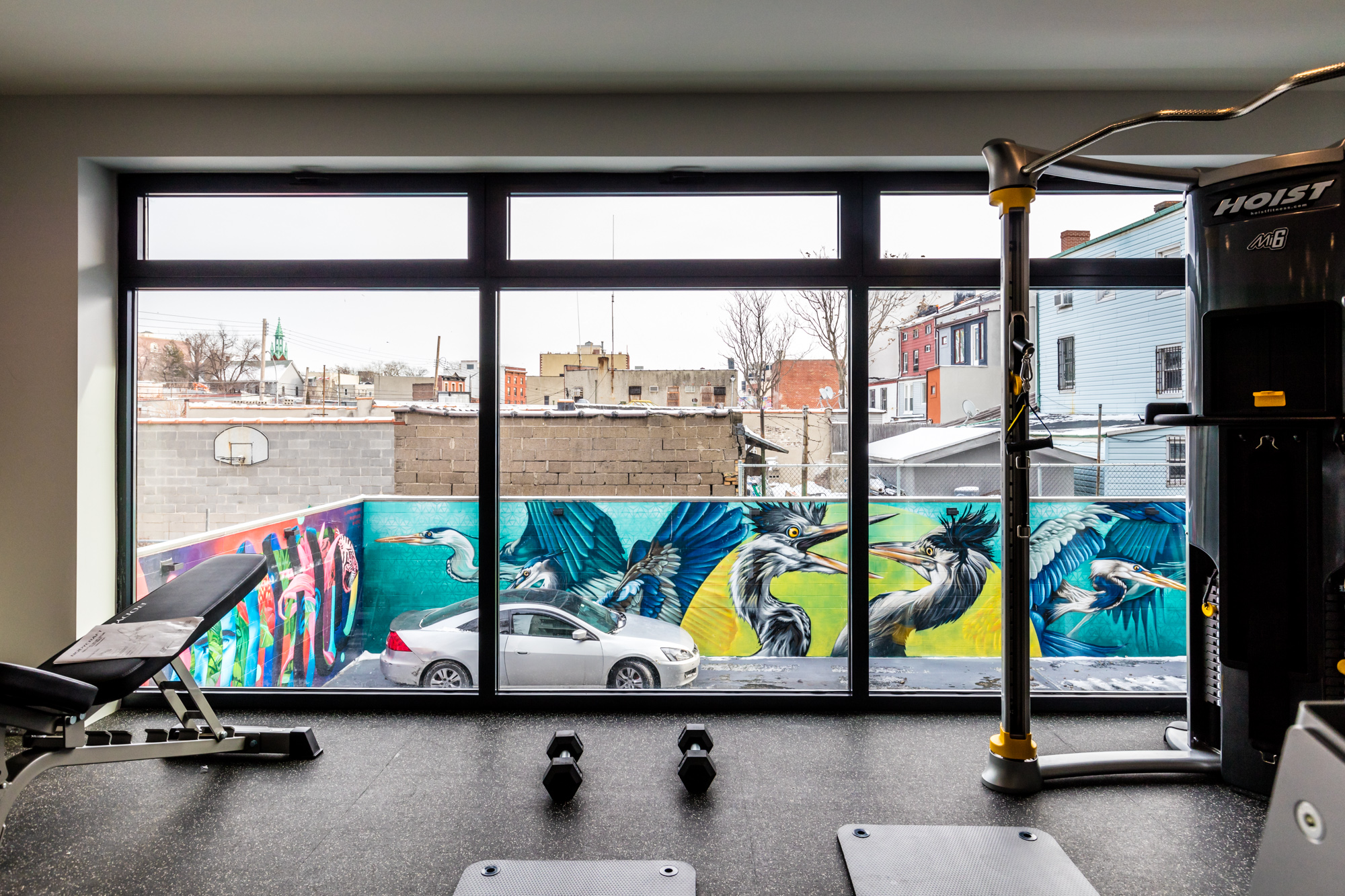 at astoria s graffiti house street art is both inspiration and the fitness center features floor to ceiling windows and overlooks the mural painted parking garage