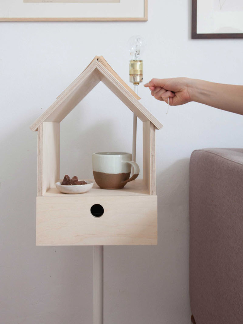 Clever 'birdhouse' side table is storage, lamp, bookmark all in ...