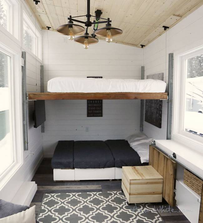 Other clever tricks here include a built in console at the center of the  home  covered by sliding doors that can pull up into two desks or one  longer. Genius tiny house is full of DIY transforming furniture   Curbed