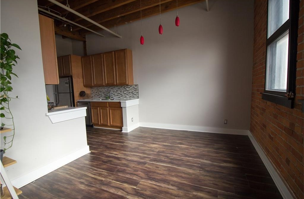 Live Across From Belle Isle In This Rivertown Loft