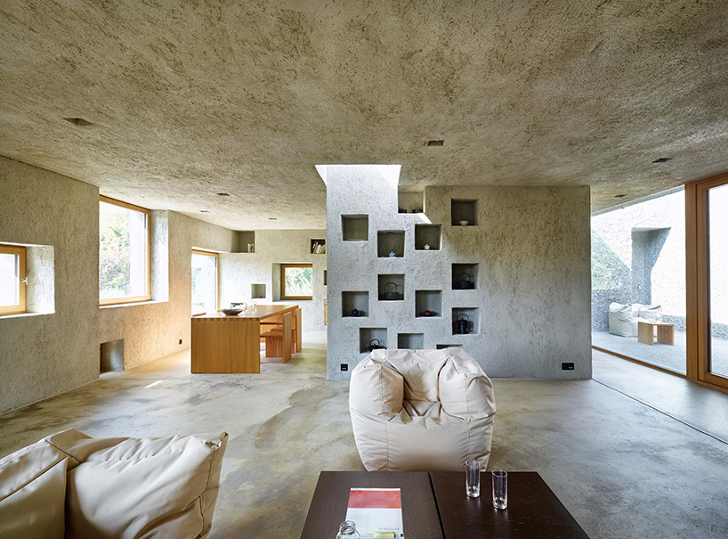concrete house in switzerland looks like a block of swiss. Black Bedroom Furniture Sets. Home Design Ideas