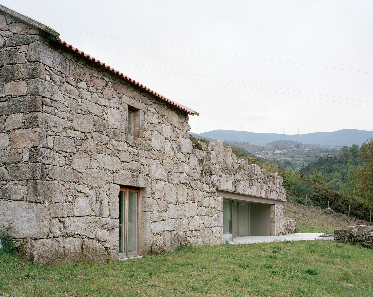 Contemporary stone house rises from old ruins in portugal for Minimalist old house
