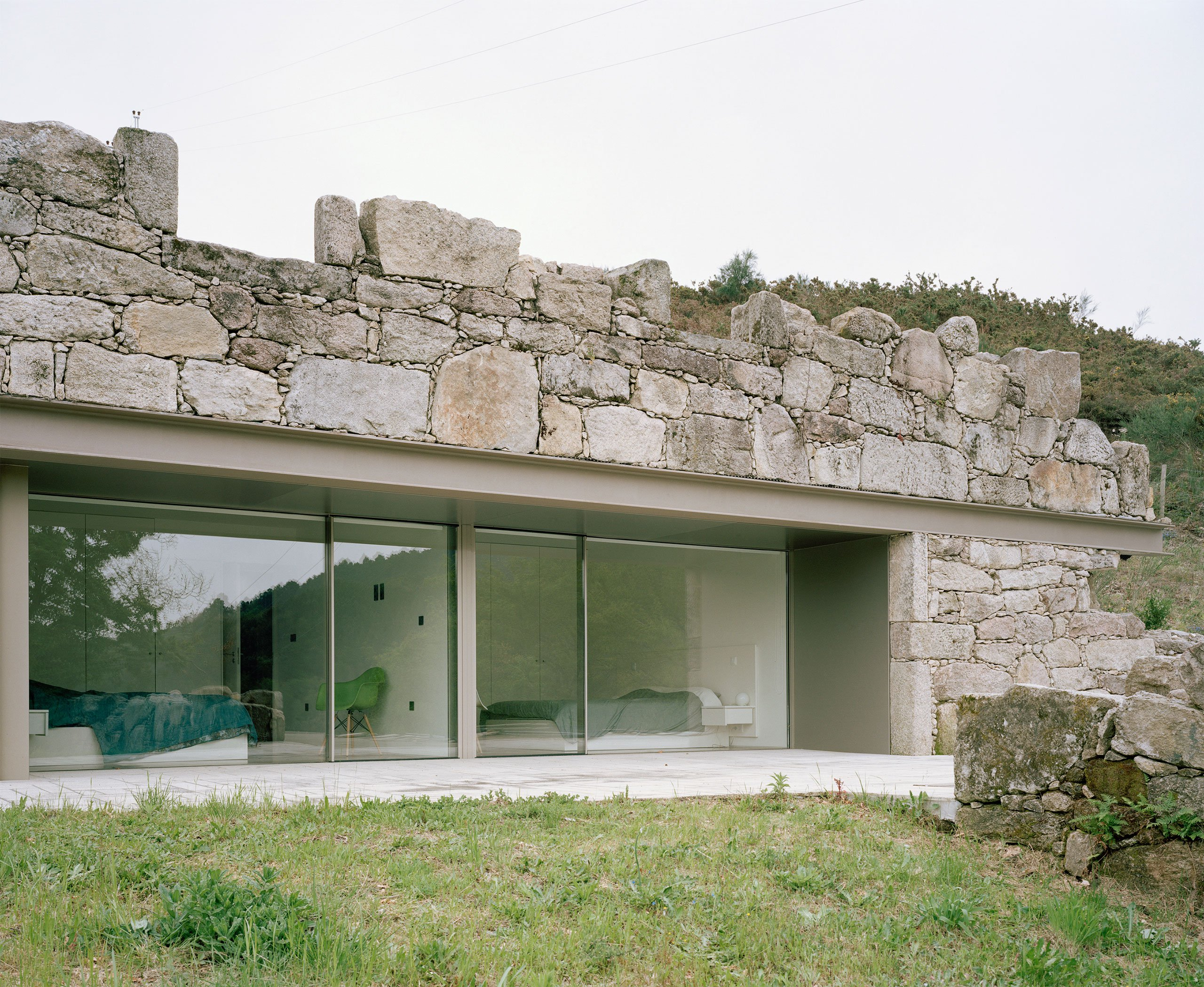 Contemporary stone house rises from old ruins in Portugal