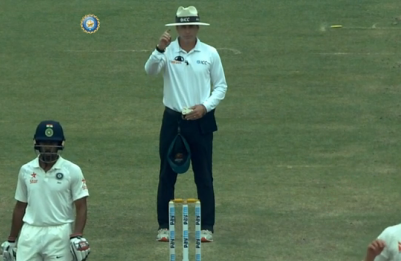 Cricket umpire botches a call and hilariously tries to play it off by scratching his head