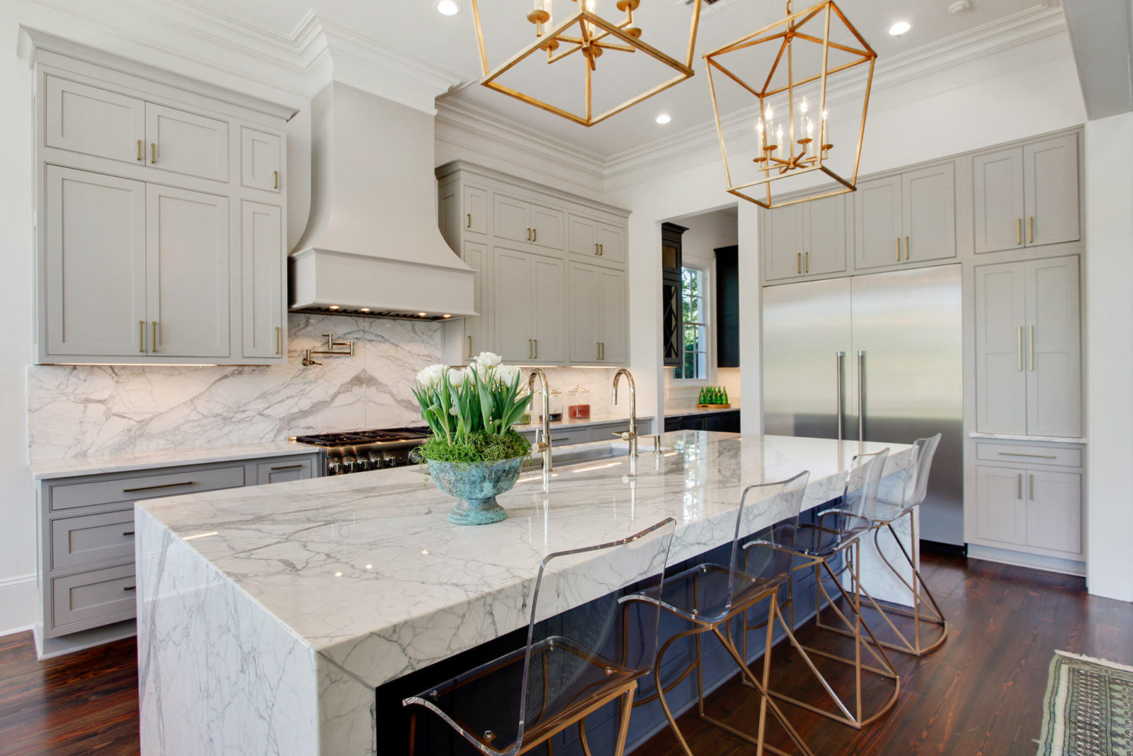 The home has an elegant kitchen  complete with statuary marble  a butler s  pantry  a walk in wine cooler  and custom wood cabinetry. Stunning Garden District double gallery home hits market at  1 75M