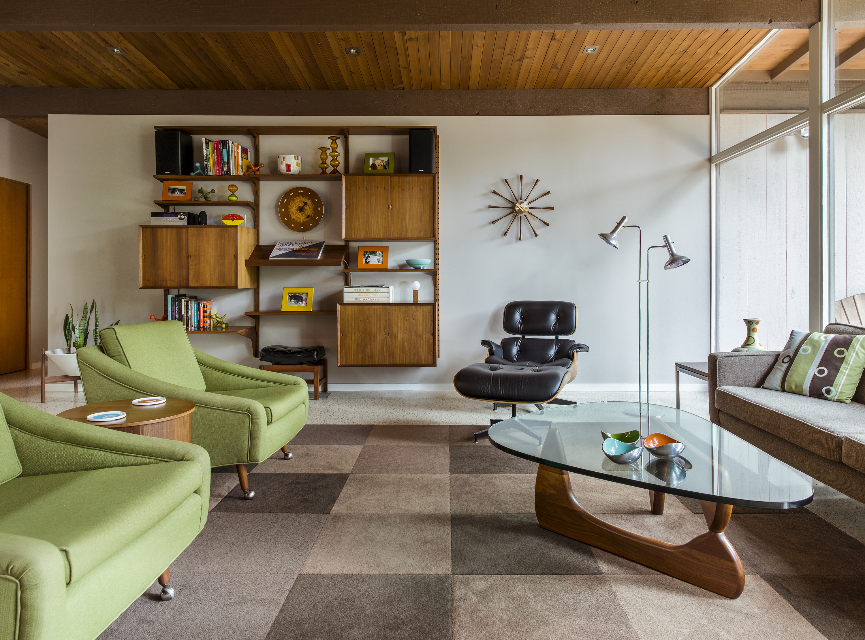 The living room is decorated with (mostly) vintage midcentury modern  furniture.