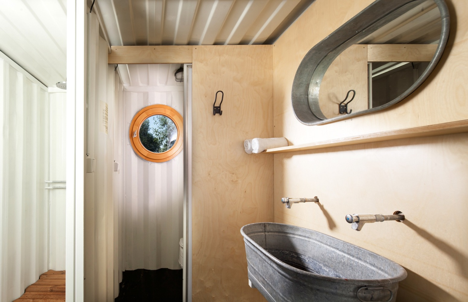 Shipping container hotel offers eco-friendly getaway for surfing nomads