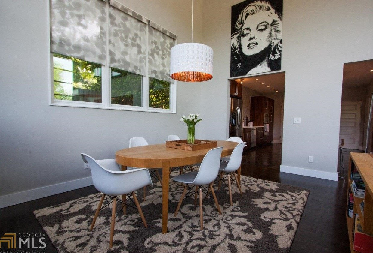The Highlight Of Property Is Third Floor This Entertainment Space Features A Built In Bar Plus Glass Garage Door That Opens To Rooftop