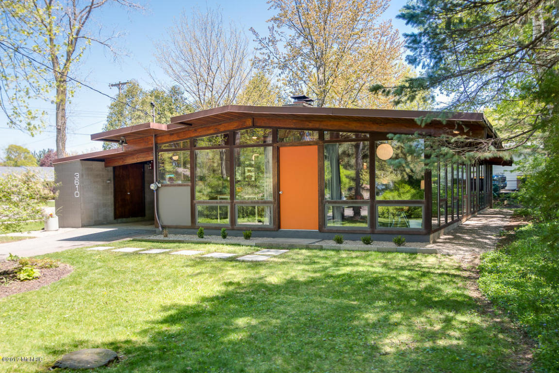 midcentury home with walls of glass asks just 159k curbed although the three bedroom one bath measures just 1 453 square feet the residence feels more than spacious thanks to the glazed great room with brick