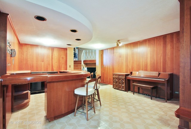 Midcentury house has time capsule tiny house in basement