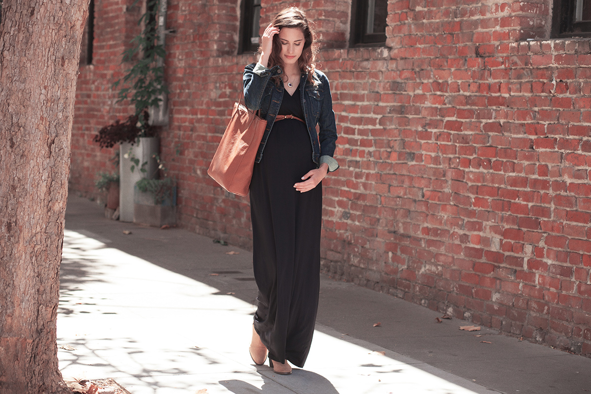 Where to buy maternity clothes youll actually want to wear racked a pregnant women in a black maxi dress and jean jacket ombrellifo Choice Image