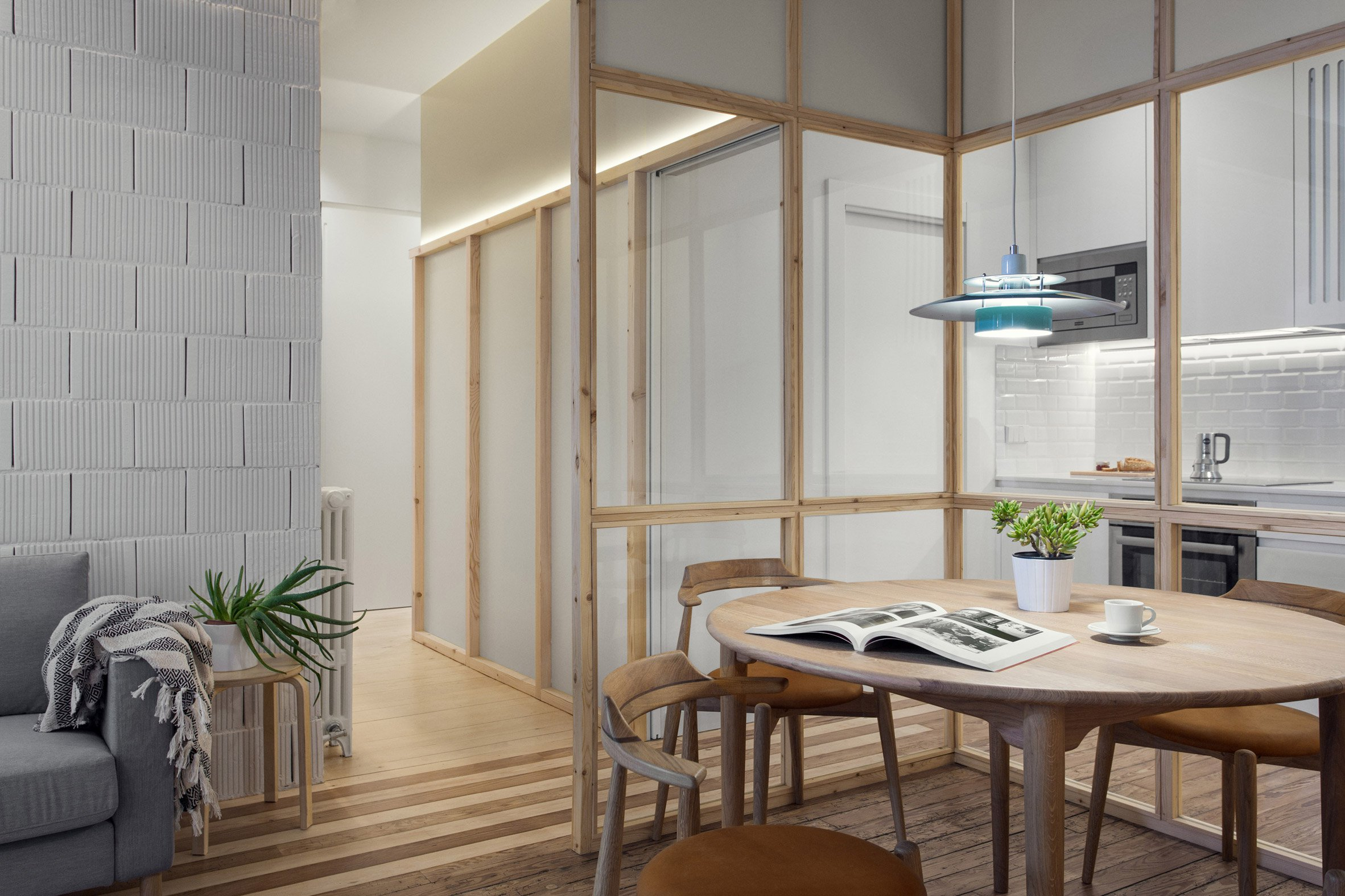 spanish apartment renovation breaks space up into zones - curbed