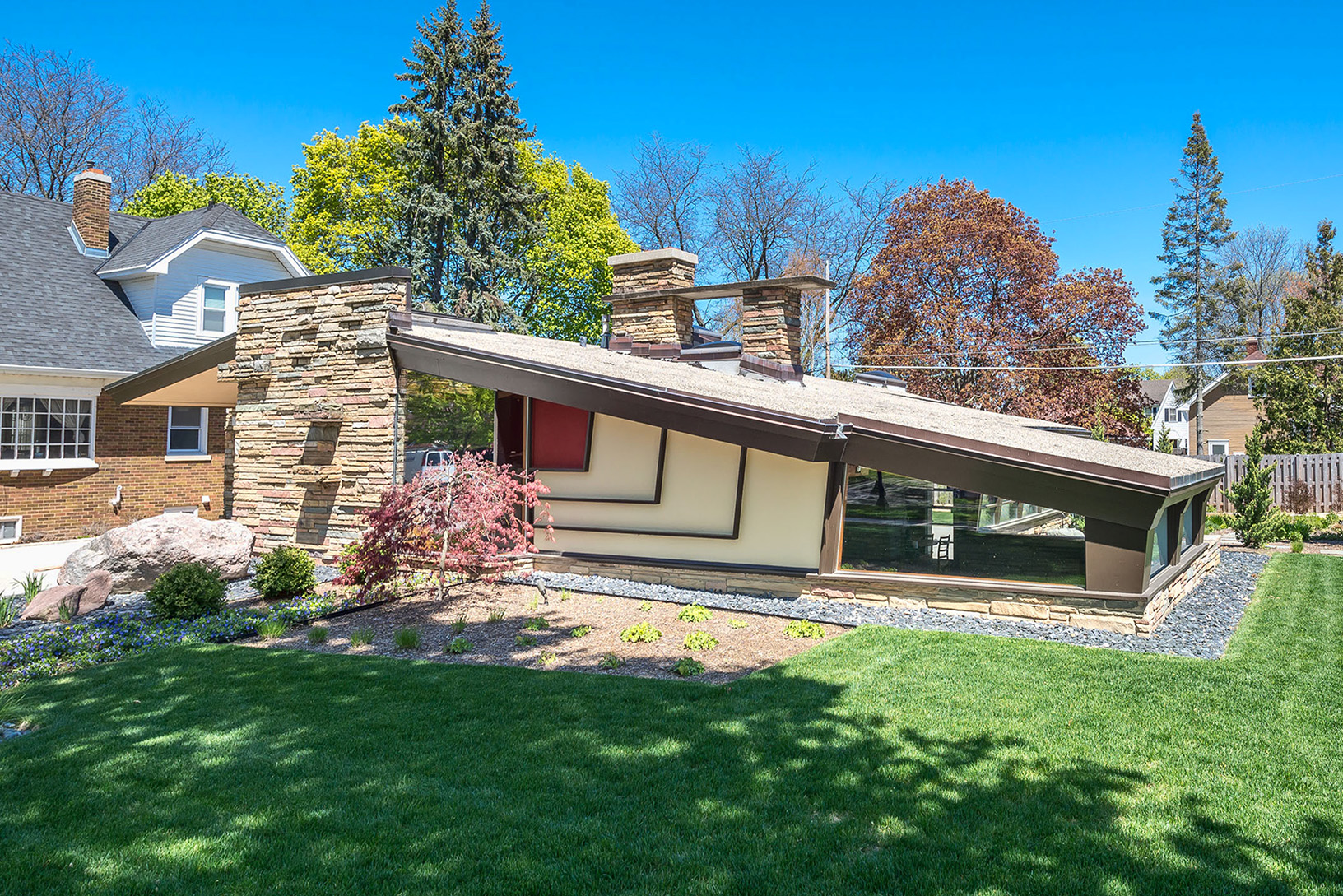 Midcentury modern home with scotch and music room and for Home builders wisconsin