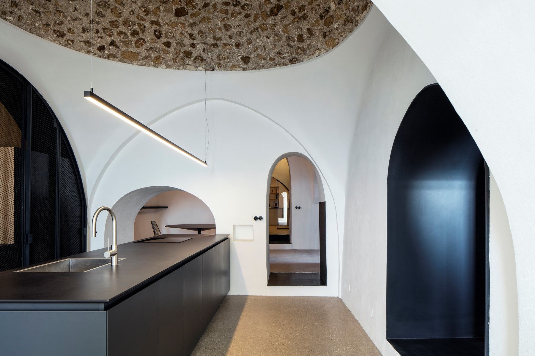 In A Brilliant Design Move The Kitchens Massive Stone Dome Was Left Un Plastered Adding Historic Statement Amid Minimalist White Interior