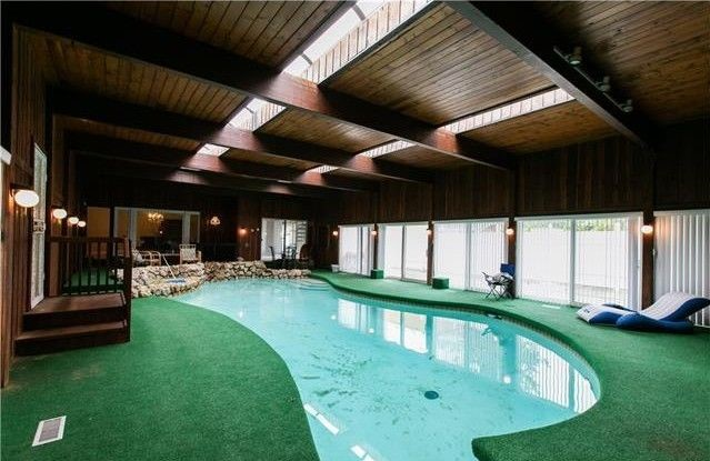 Big Mansions With Indoor Pools swim inside this palmer woods mansion, now down to $538k - curbed